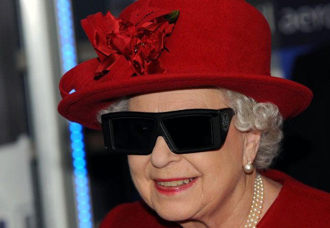 Britain's Queen Elizabeth II  wears 3 D glasses to watch a display and control a mechanical digger during a visit to the University of Sheffield Advanced Manufacturing Research Centre. in Sheffield England Thursday Nov. 18, 2010.  (AP Photo/John Giles/PA) UNITED KINGDOM OUT